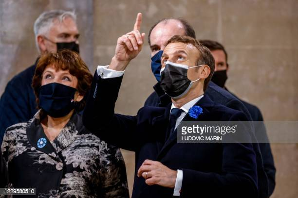 French Culture Minister Roselyne Bachelot, French President Emmanuel Macron and French Prime Minister Jean Castex speak during a ceremony at the...
