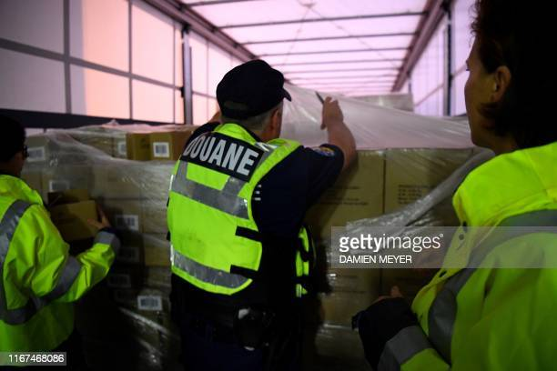 French customs officers check goods in a lorry coming from Great Britain on September 12 2019 at French customs in Ouistreham harbour northwestern...