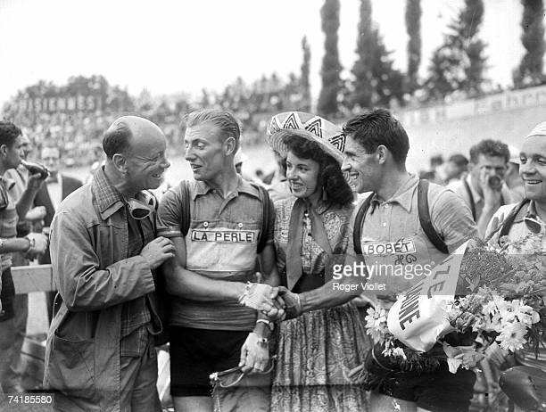 French cyclist Andre Darrigade winner of the 6th stage of the Tour de France in Zurich 13th July 1955 is congratulated by fellow cyclist Antonin...
