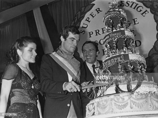French cyclist Bernard Hinault cuts the cake at a reception in Paris to celebrate his 25th birthday, 15th November 1979. Hinault won the Tour de...
