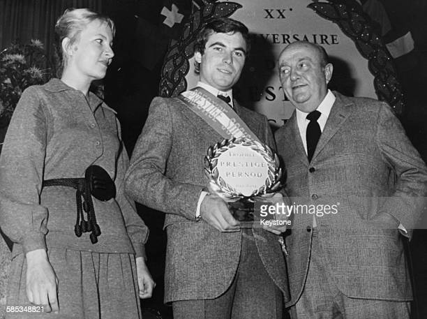 French cyclist Bernard Hinault receiving the Prestige Pernod sport award from comedians Genevieve Casile And Bernard Blier, circa 1975.
