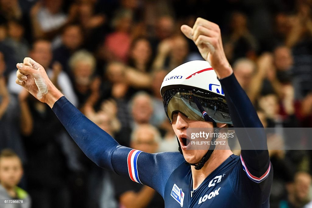 French cyclist Corentin Ermenault celebrates after winning gold medal in the men's individual pursuit at the European Track Championships Saint Quentin en Yvelines on October 22, 2016. / AFP / PHILIPPE