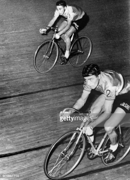 French cyclist Louison Bobet and Jacques Anquetil take part to the race Six Days of Paris in 1957 at the Vélodrome d'hiver in Paris / AFP PHOTO /
