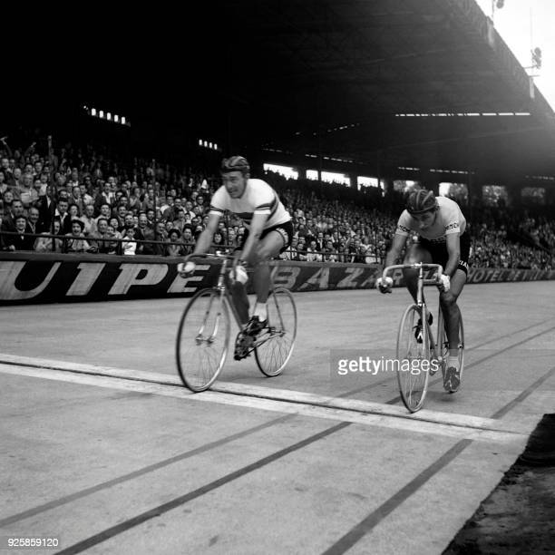 French cyclist Louison Bobet crosses the finish line as Italian cyclist Fausto Coppi arrives second on July 3 1955 during the speed event at the Parc...