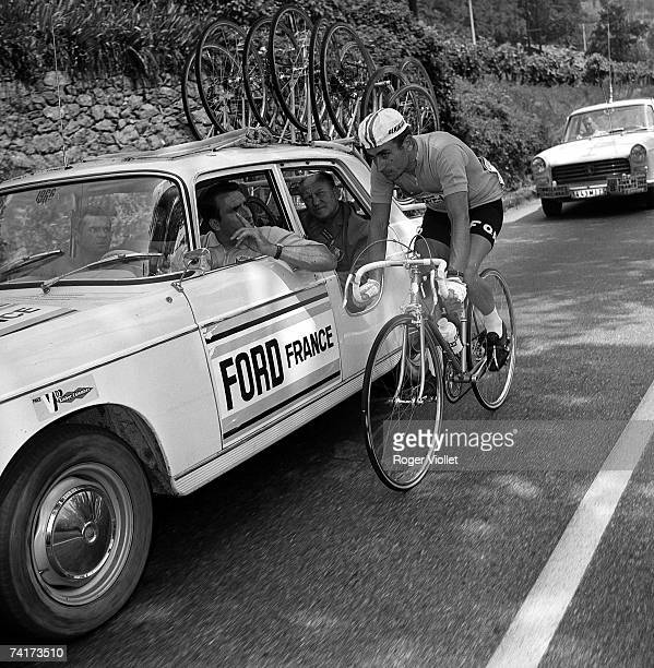 French cyclist Lucien Aimar, talking to his sports director Raphael Geminiani during the 1966 Tour de France which he went on to win.