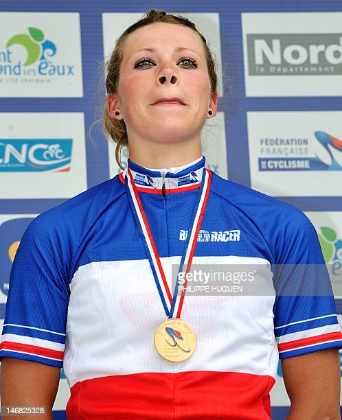 French cyclist Marion Rousse awarded with the gold medal cries on the podium after winning the ladies road race of the France's cycling Championships...