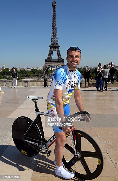 COURBET == French cyclist PierreMichael Micaletti poses on June 5 2013 in front of the Eiffel tower in Paris While some cycle the ParisNice route in...