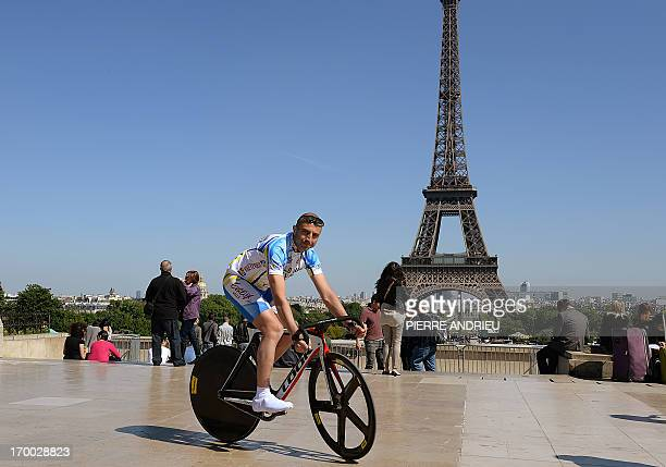 COURBET == French cyclist PierreMichael Micaletti rides his bike on June 5 2013 in front of the Eiffel tower in Paris While some cycle the ParisNice...