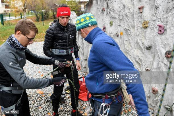 French cyclist Romain Bardet from the AG2R team climbs on a climbing wall in Vaujany on November 15 2017 as part of a preparation training / AFP...