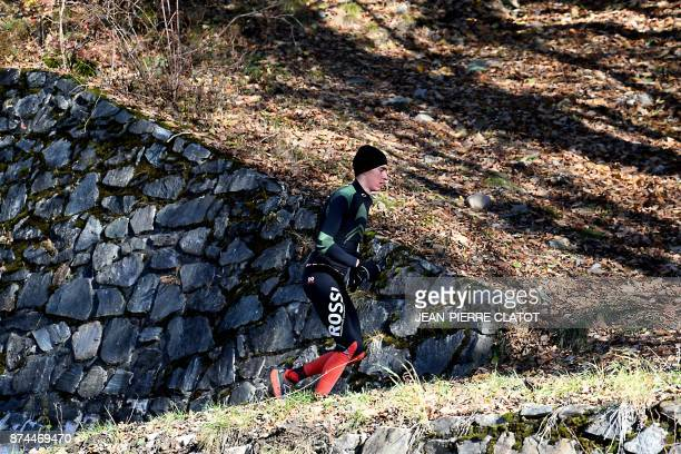 French cyclist Romain Bardet from the AG2R team runs in Vaujany on November 15 2017 as part of a preparation training / AFP PHOTO / JEANPIERRE CLATOT