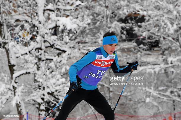 French cyclist Romain Bardet performs a cross country ski exhibition as part of the IBU Biathlon World Cup in Le Grand Bornand on December 17 2017 /...