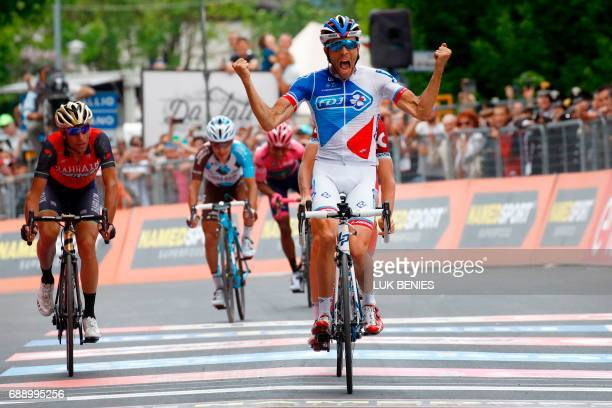 French cyclist Thibaut Pinot of Team FDJ crosses the finish line and wins the 20th stage of 100th Giro d'Italia Tour of Italy from Pordenone to...