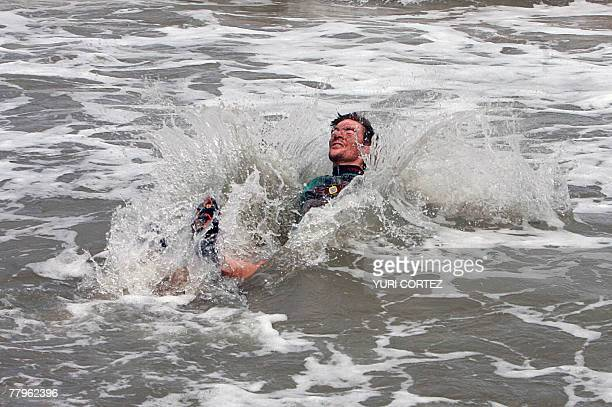 French cyclist Thomas Dietsch bronze medalist in the Mountainbike World Championship in Verviers Belgium celebrates plunging into the sea 17 November...