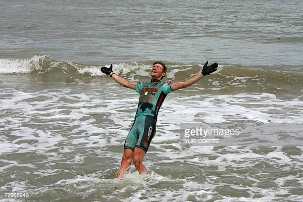 French cyclist Thomas Dietsch bronze medalist in the Mountainbike World Championship in Verviers Belgium celebrates taking a sea bath 17 November...