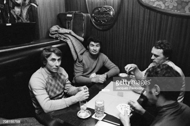 French cyclists Jacques Anquetil and Raymond Poulidor playing cards on a set during the launch of the new French TV channel Antenne 2 6th January 1975