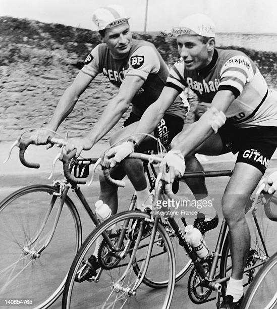 French cyclists Raymond Poulidor and Jacques Anquetil during the first stage in the Pyrenees mountains of the Tour de France on July 2, 1963 in...
