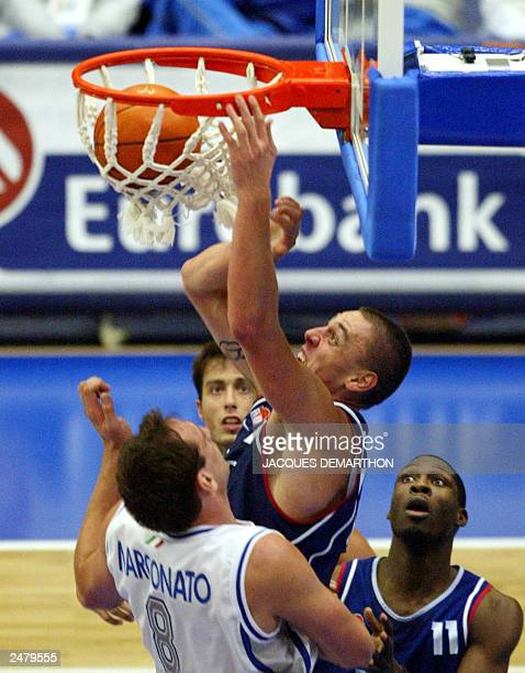 French Cyril Julian scores as teammate Florent Pietrus and Italian Dennis Marconato watch, during the match France vs. Italy at the Euro 2003...