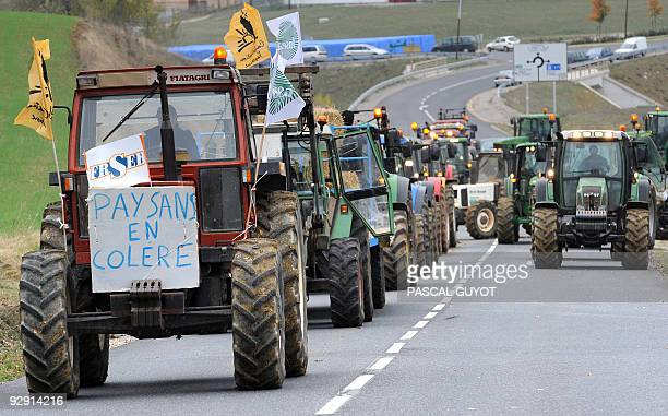 French dairy farmers drive their tractors to slow down the traffic on November 9, 2009 in Roquefort-sur-Soulzon, central France, prior to a meeting...