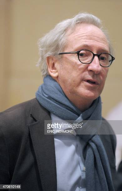 French dairy food giant Danone Chairman Franck Riboud arrives for a press conference to present the group's 2013 results in Paris on February 20,...