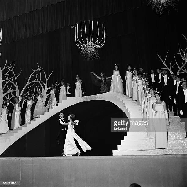 French dancer Jacques Chazot and French actress Brigitte Fossey opening a debutante ball at Palais de Chaillot in Paris