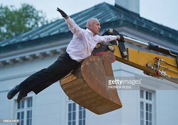 French dancer Philippe Priasso performs a Pas de Deux with a Digger during the NeuhardenbergNacht on May 18 2013 at Neuhardenberg Palace in...