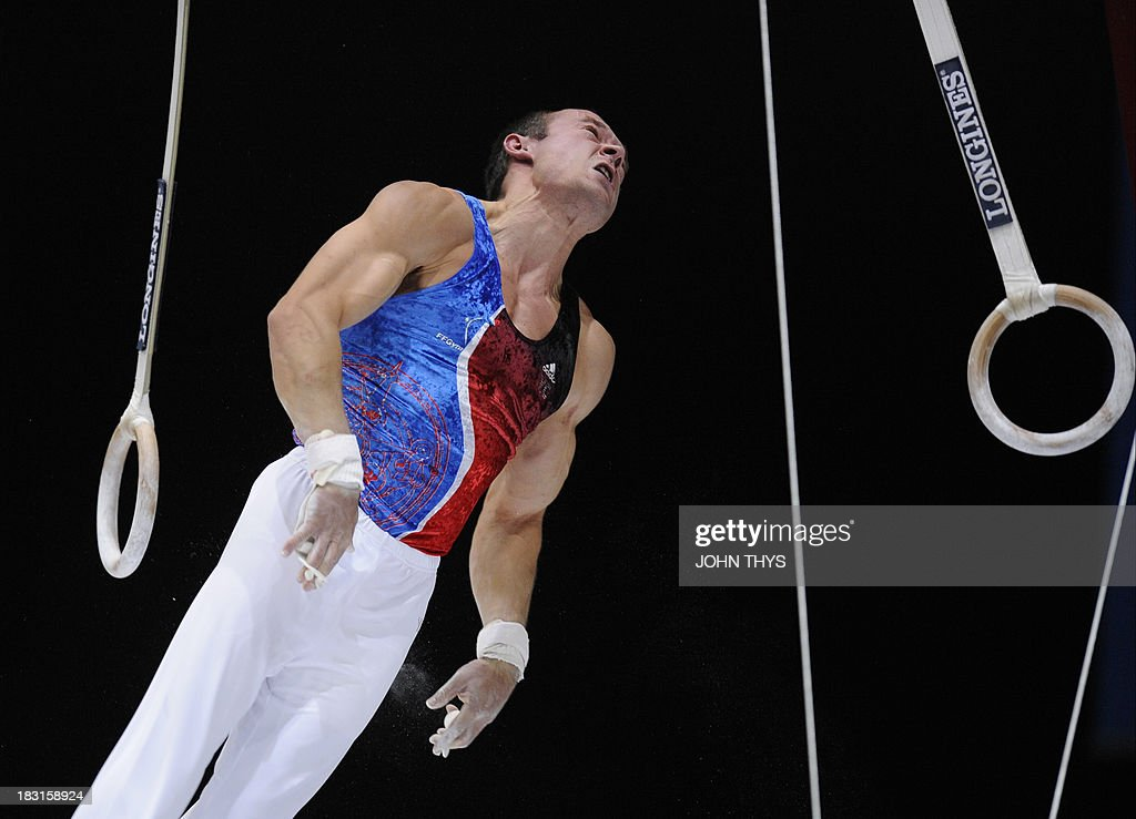 French Danny Pinhoheiro Rodrigues performs during the men's rings final at the 44th Artistic Gymnastics World Championships in Antwerp on October 5, 2013.
