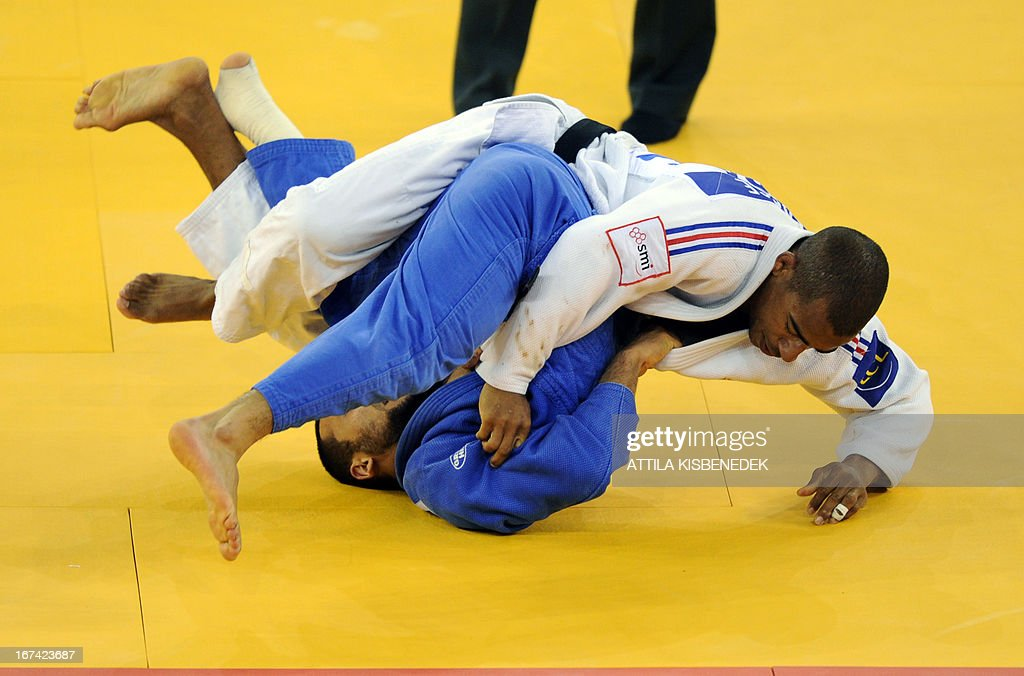 French David Larose (white) fights with Russian Kamal Khan-Magomedov (blue) during the Judo European Championships in 66kg category for men in Budapest.