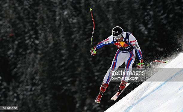 French David Poisson speeds down the famous Hahnenkamm downhill during FIS Ski World Cup in Kitzbuhel on January 24 2009 Switzerland's Didier Defago...