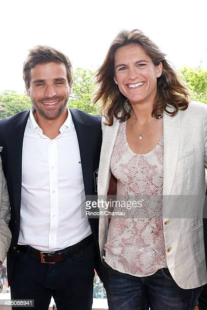 French Davis Cup Arnaud Clement and Roland Garros TV host for France Television and French Fed Cup captain Amelie Mauresmo pose at France Television...