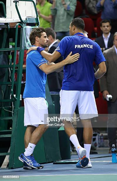 French Davis Cup captain Arnaud Clement congratulates JoWilfried Tsonga of France after his victory during the second round Davis Cup match between...