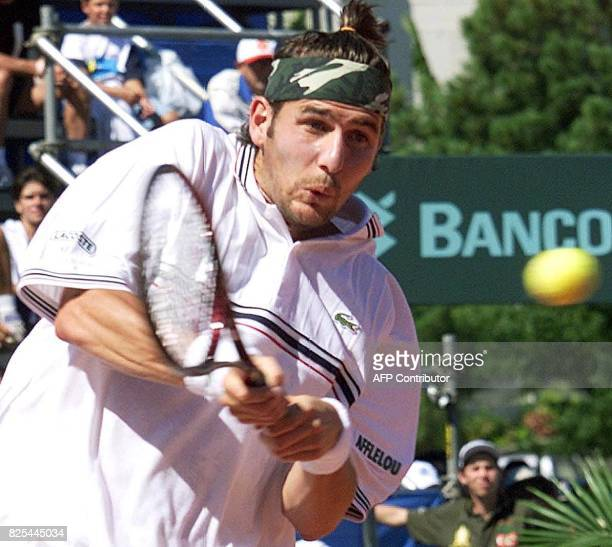 French Davis Cup player Jerome Golmard returns a shot to opponent Gustavo Kuerten of Brazil during their 04 February 2000 match at Federal University...