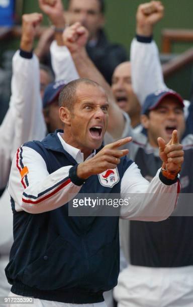 French Davis cup team captain Guy Forget jubilates after France's Arnaud Clément won a point against his US opponent Andy Roddick 20 september 2002...
