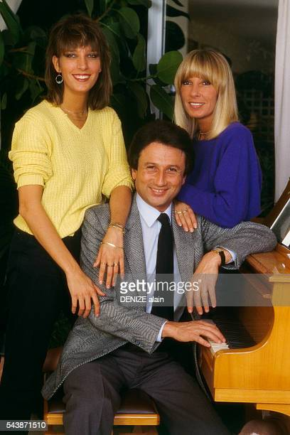 French decorator Stéphanie Jarre television presenter Michel Drucker and actress Dany Saval during a family gettogether at home