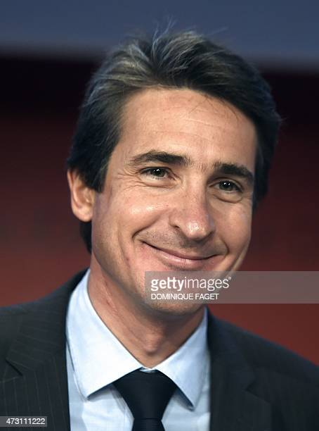 French defence contractor Thales' Chief Executive Officer Patrice Caine smiles as he poses during the company's general meeting on May 13 2015 in...