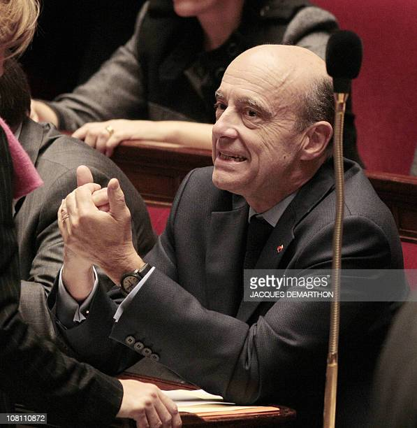 French Defence Minister Alain Juppe gestures as he takes part in the weekly session of the questions to the government on January 18 2011 at the...