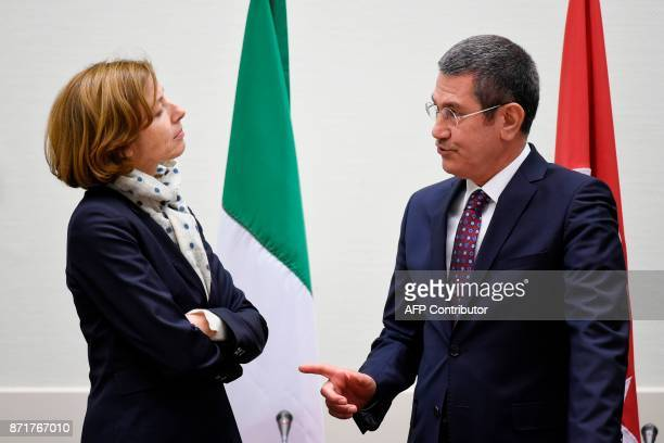 French defence minister Florence Parly and Turkish defence minister Nurettin Canikli speak together during a meeting with Italian counterpart to sign...