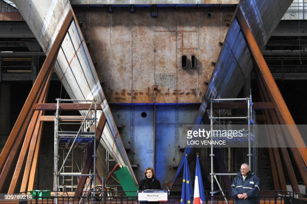 French Defence Minister Florence Parly delivers a speech next to Naval Group CEO and chairman Herve Guillou in front of a piece of a hull of a FREMM...