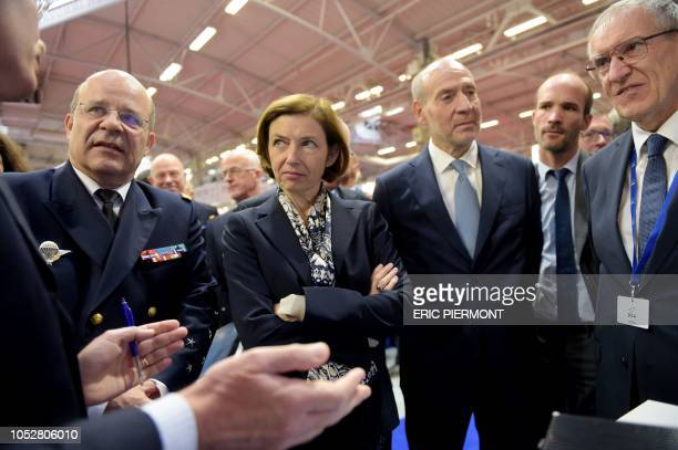 French Defence Minister Florence Parly listens explanations flanked by French Navy Chief of Staff Christophe Prazuck during the opening of Euronaval...