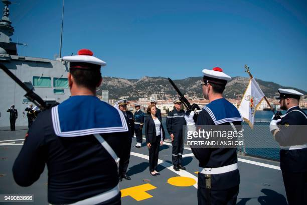 French Defence Minister Florence Parly listens to the French national anthem onboard the FREMM 'Languedoc' in Toulon southern France on April 20 one...