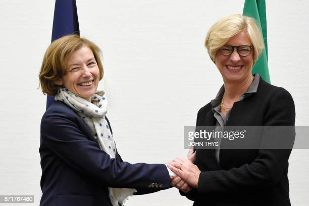 French defence minister Florence Parly shakes hands with Italian defence minister Roberta Pinotti during a meeting with Turkish counterpart to sign a...