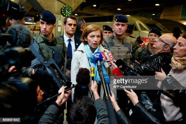 French Defence Minister Florence Parly speaks to the press as she is flanked by French soldiers of the Sentinelle military force security mission...