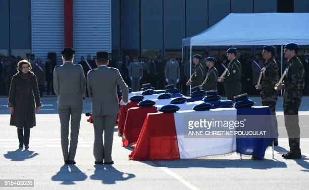 French Defence Minister Florence Parly stands by caskets during a national tribute ceremony to five helicopter pilot officers killed after two army...