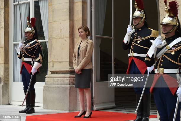 French Defence Minister Florence Parly stands guard at the entrance of the Hotel de Brienne the Ministry of Defence as she waits for the arrival of...