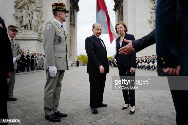 TOPSHOT French Defence Minister Florence Parly stands next to Lebanon's President General Michel Aoun during a welcome ceremony under the Arc de...