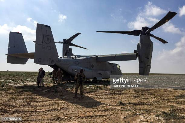 French Defence Minister Florence Parly's delegation disembarks from a US Marine Corps V22 Osprey after landing at a French artillery forward...