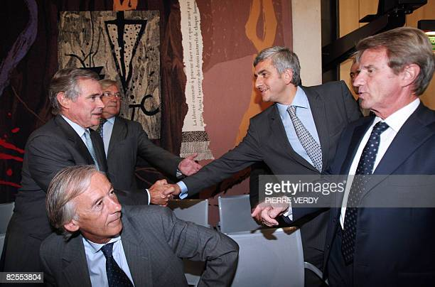 French Defence minister Herve Morin shakes hands with president of the National Assembly Bernard Accoyer next to Foreign Affairs minister Bernard...