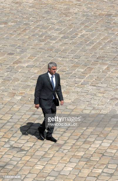 French Defence Minister Herve Morin walks on June 05, 2009 in the Invalides building in Paris to attend a ceremony to award veterans from...