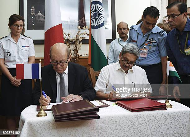 French defence minister Jean Yves le Drian and Indian defence minister Manohar Parrikar sign the the deal for India's purchase of 36 French Rafale...