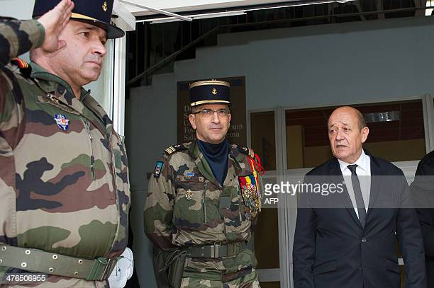 French Defence Minister Jean Yves Le Drian arrives to pay tribute to late Master Corporal Damien Dolet who died during 'Operation Sangaris' in the...