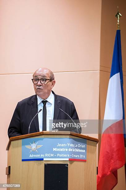 French Defence Minister Jean Yves Le Drian delivers a eulogy as he pays tribute to late Master Corporal Damien Dolet who died during 'Operation...
